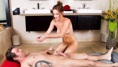 Nude masseuse Casana Lei pouring Nuru Gel on client